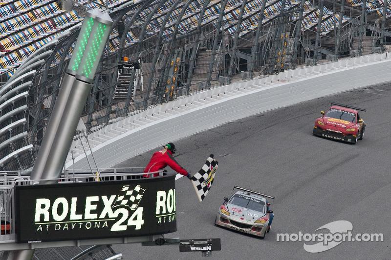 #40 Dempsey Racing Mazda RX-8: Patrick Dempsey, Charles Espenlaub, Joe Foster and #43 Team Sahlen Mazda RX-8: Joe Nonnamaker, Wayne Nonnamaker, Will Nonnamaker, Joe Sahlen take the checkered flag