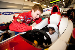 Oliver Turvey meets local children visiting the circuit