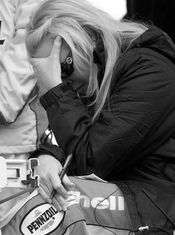 Delana Harvick watches the race as her husband battles for the lead with one lap to go