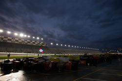 A wet Daytona International Speedway at dusk