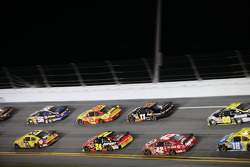 Clint Bowyer, Richard Childress Racing Chevrolet and Martin Truex Jr., Michael Waltrip Racing Toyota lead a group of cars