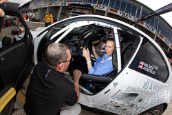 Artist Jeff Koons in the BMW Rahal Letterman Racing Team BMW E92 M3 as he will create the next BMW art car