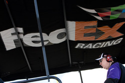 Mike Ford stands on top of the No. 11 FedEx pit box