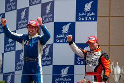 Giacomo Ricci celebrates his victory on the podium with Sam Bird