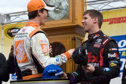 Victory lane: race winner Denny Hamlin, Joe Gibbs Racing Toyota congratulated by Joey Logano, Joe Gibbs Racing Toyota