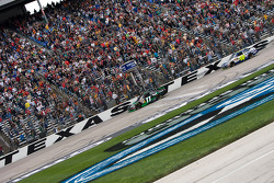Denny Hamlin, Joe Gibbs Racing Toyota takes the checkered flag in front of Jimmie Johnson, Hendrick Motorsports Chevrolet