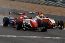 Daisuke Nakajima and Esteban Gutierrez race to the finish line on the last lap