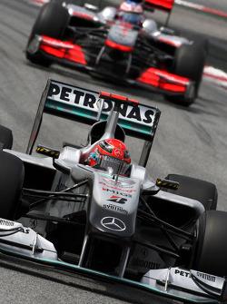 Michael Schumacher, Mercedes GP Petronas leads Jenson Button, McLaren Mercedes