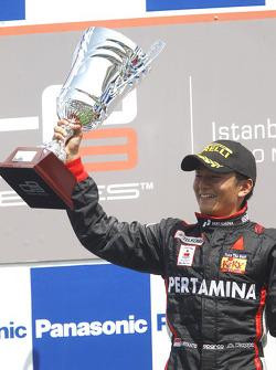 Rio Haryanto celebrates victory on the podium