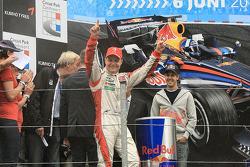 Valtteri Bottas celebrates as Sebastian Vettel looks on