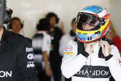 Fernando Alonso, McLaren MP4-31 adjusts his helmet in the garage