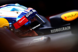 Daniel Ricciardo, Red Bull Racing sits in his car in the garage
