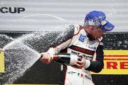 Podium: winner Matteo Cairoli celebrates with champagne