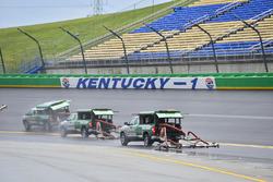 Track workers attempt to dry the track