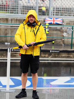 Andy Stobart, Renault Sport F1 Team Press Officer as a rain storm hits the circuit before qualifying
