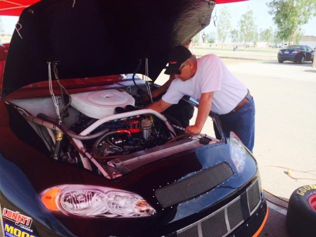 JSR Team Manager John Krebs does some carb tuning