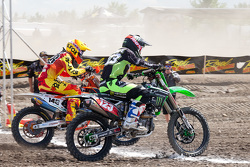 The holeshot winner in the MX1 second moto goes to KTM's Cole Thompson #148 by a tire width